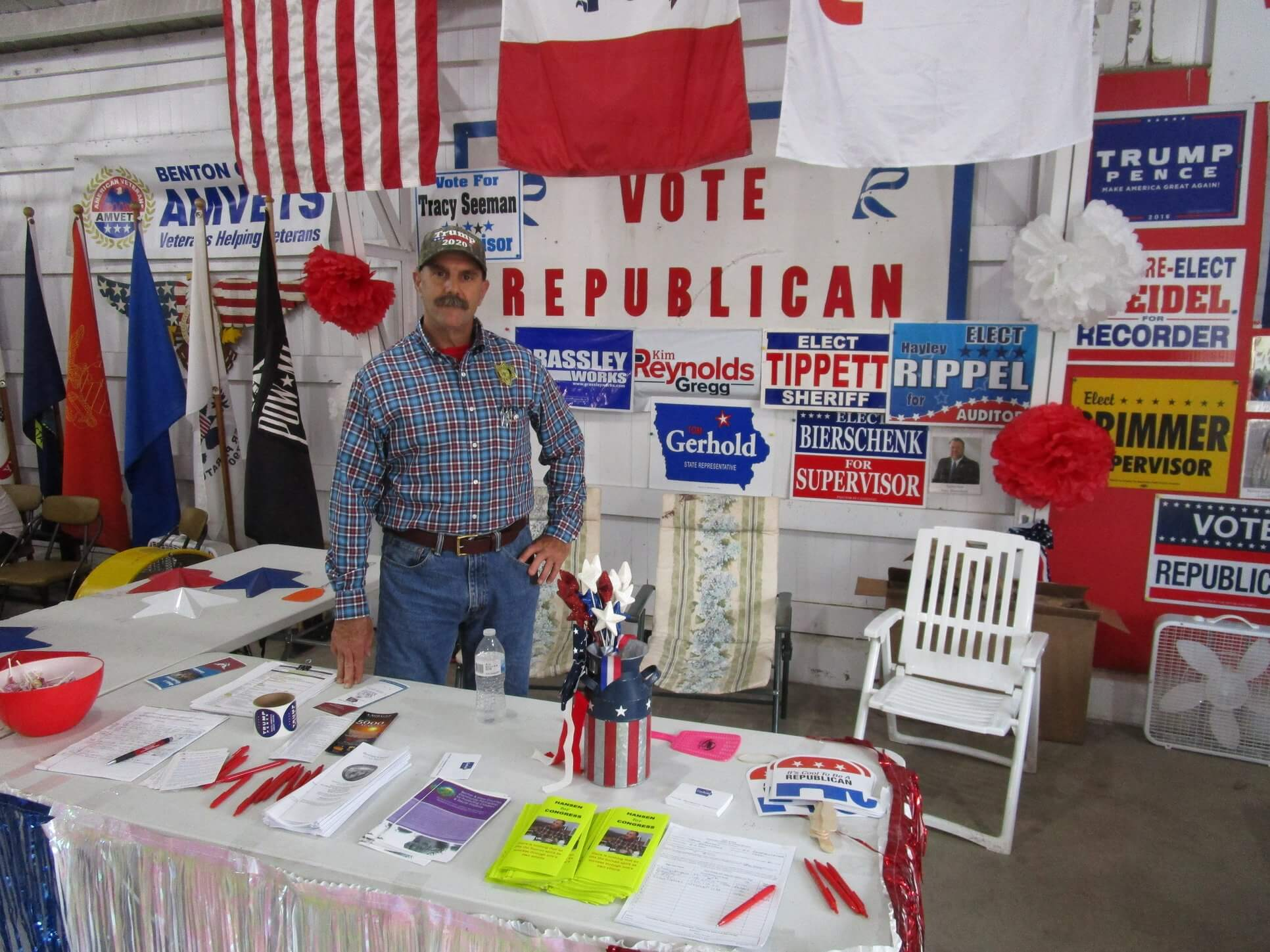 Thomas Hansen seated at Benton County Fair booth